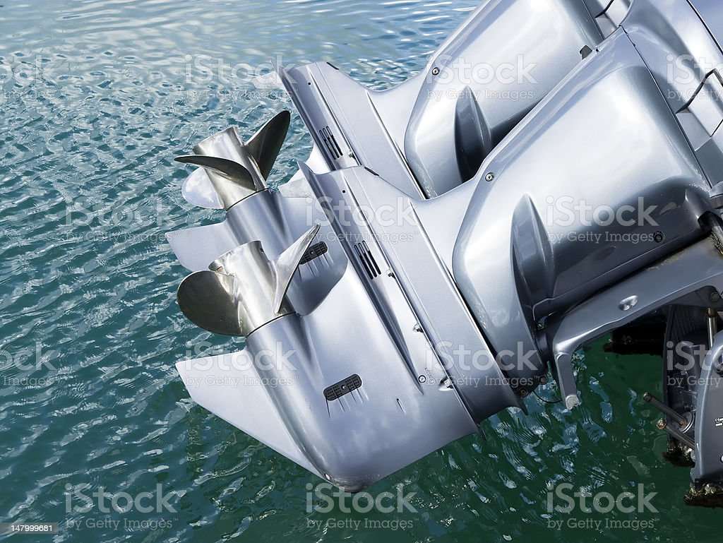 Top view of outboard motor propeller flying above water stock photo