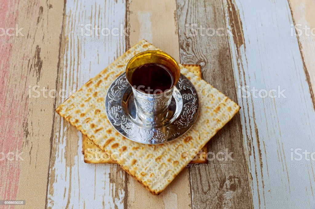 Top view of passover background. wine and matzoh jewish holiday bread stock photo