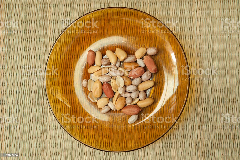 Top view of Peanut in  plate on the bamboo mats stock photo
