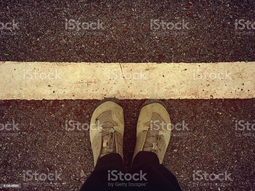 Top View of person of Hiking boots standing at  line royalty-free stock photo