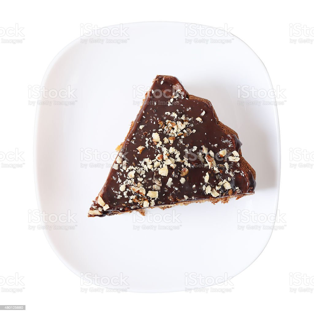 Top view of piece of glazed and sprinkled cake stock photo