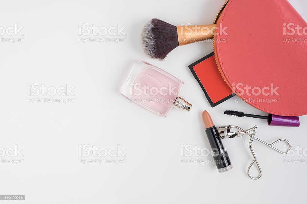 Top view of pink cosmetic bag and make up products stock photo