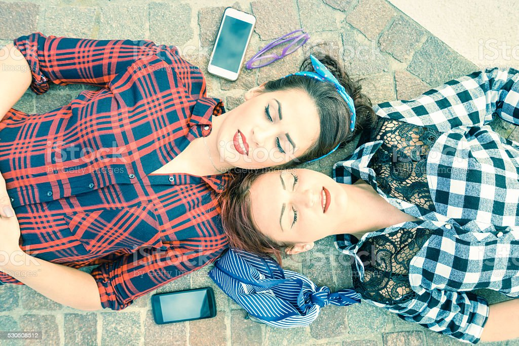 Top view of pinup retro styled girlfriends on relax moment stock photo