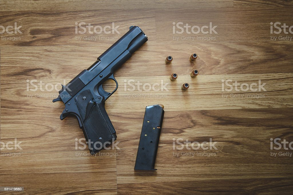 Top view of Pistol semi-automatic .45 caliber with magazine and stock photo