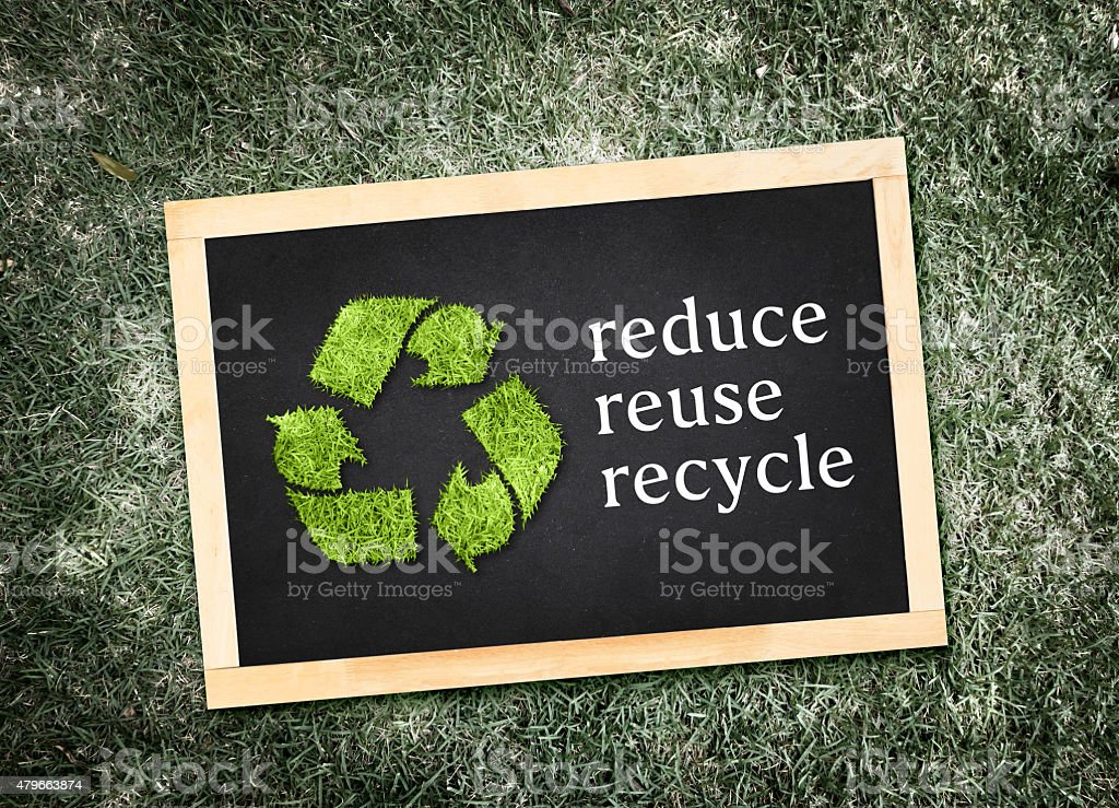 Top view of recycle symbol and 'reduce reuse recycle' stock photo