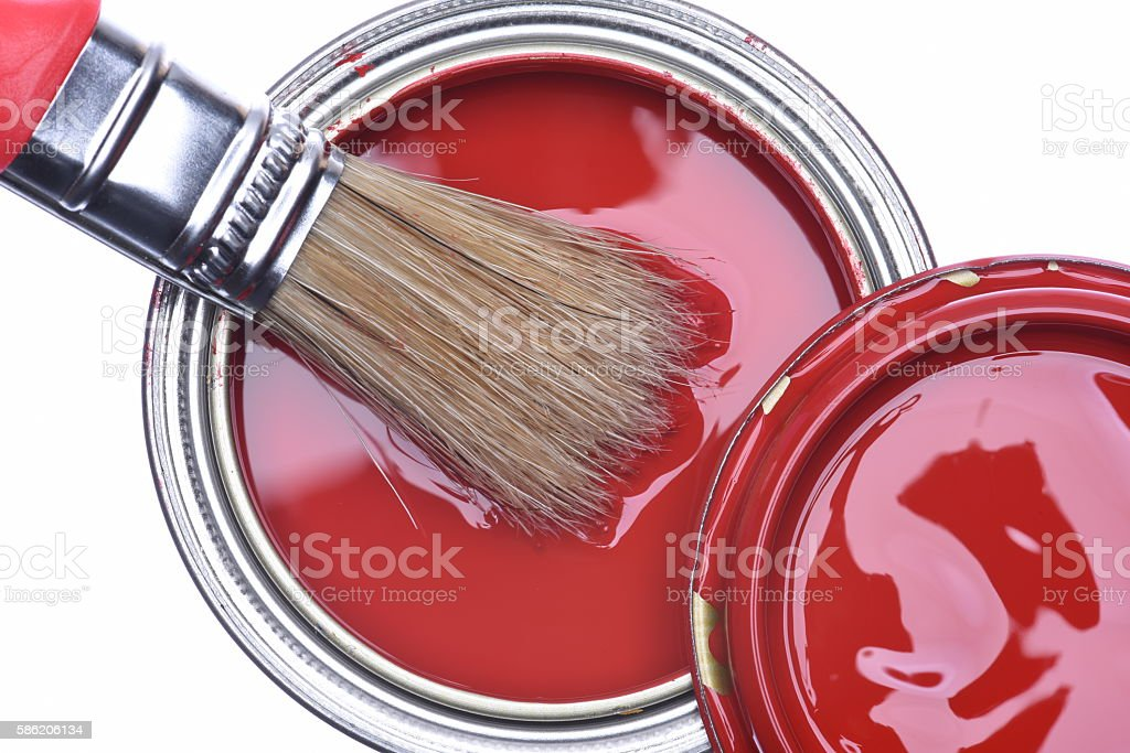 Top view of red paint can with brush stock photo