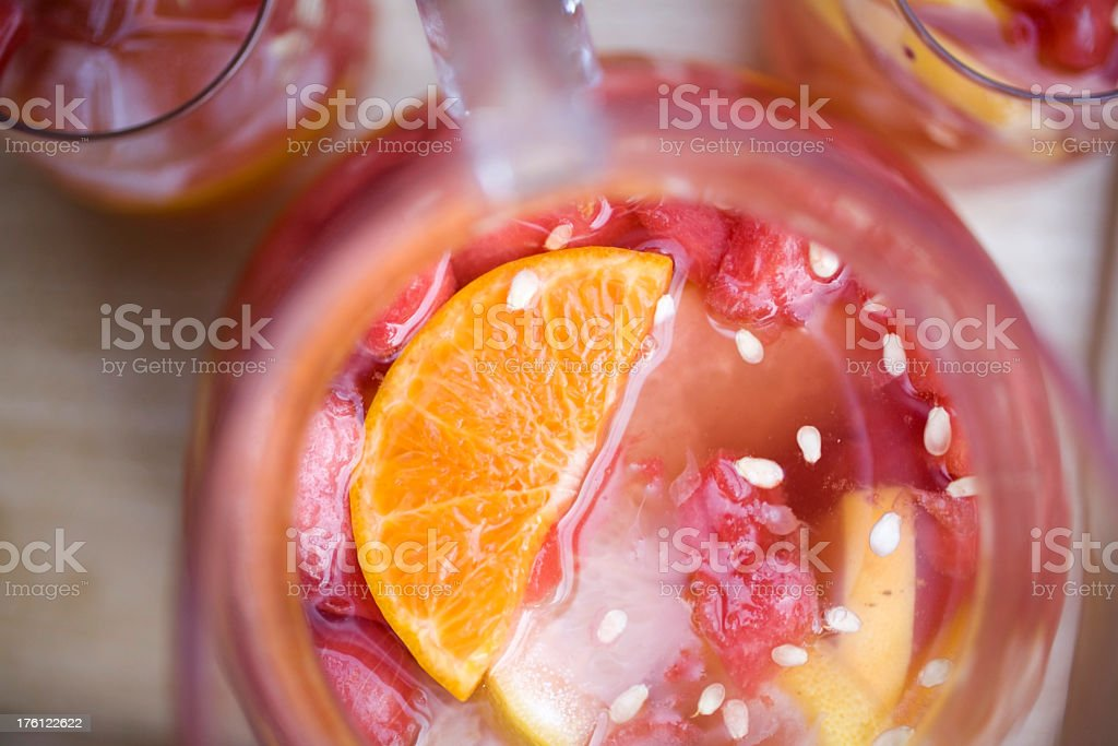 Top view of red sangria pitcher and glasses with orange stock photo