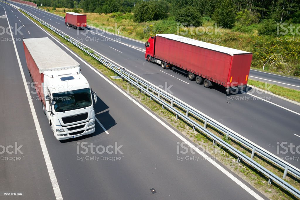 Top view of red trucks driving on a highway stock photo