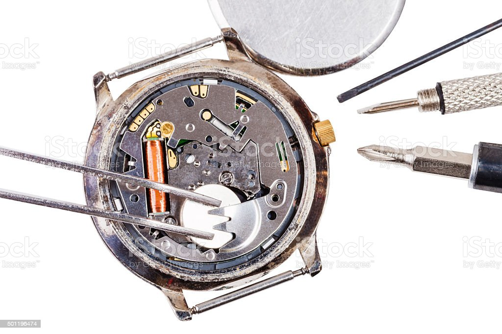 top view of replacing battery in quartz watch stock photo