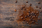 Top view of roasted coffee beans and ground coffee