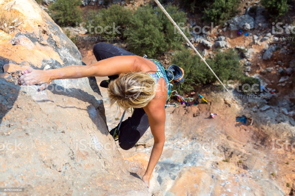 Top View of Rock Climber on high vertical Wall stock photo