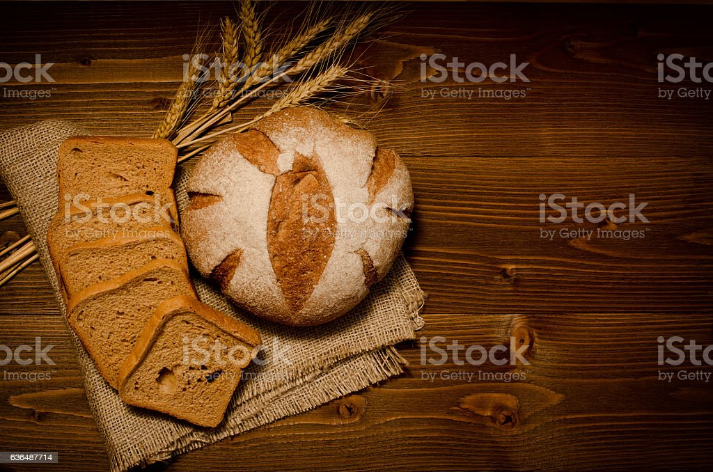 Top view of round rye bread on sackcloth stock photo