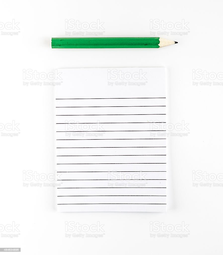 Top view of Ruled paper notepad with green pencil stock photo