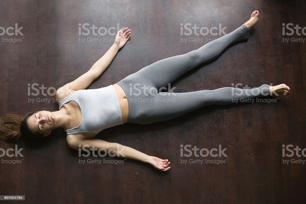 Top view of Shavasana yoga posture stock photo