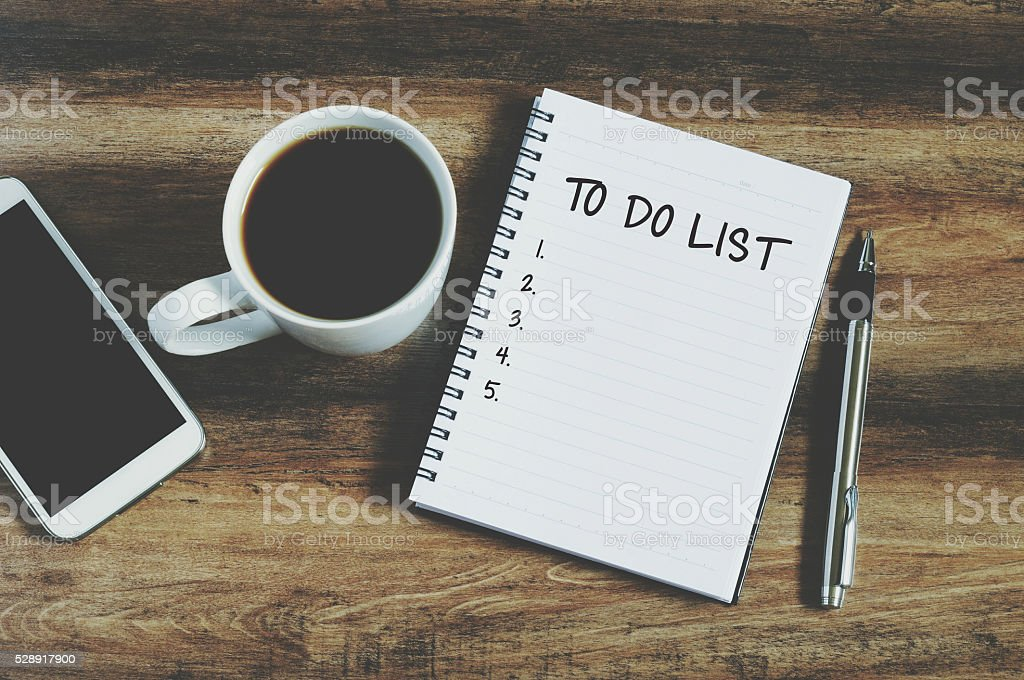 Top view of smart phone, coffee, pen and notepad stock photo