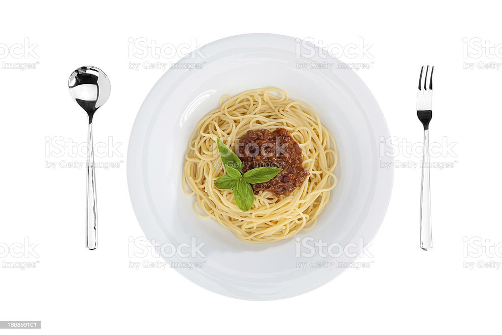 top view of spaghetti bolognese with silverware royalty-free stock photo
