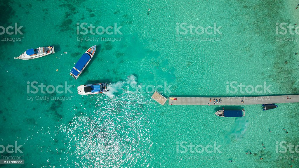 top view of speed boat approaching to jetty over clear stock photo
