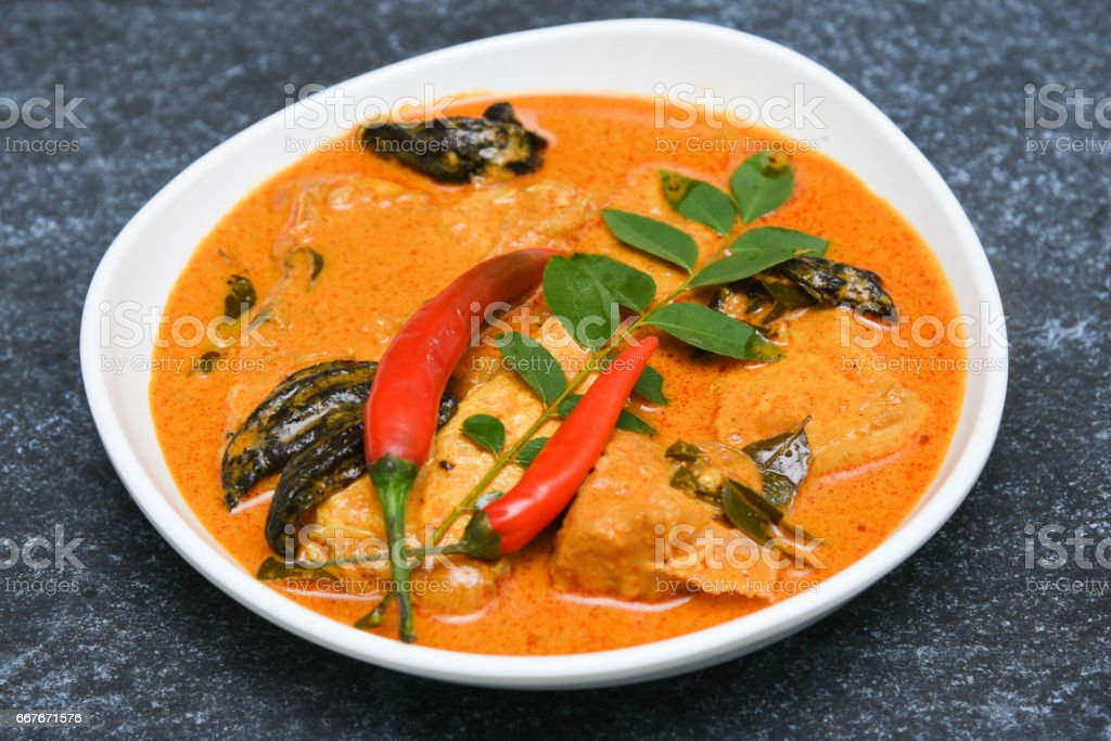 Top view of spicy and hot king fish curry Kerala Indian food stock photo