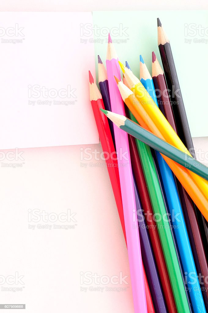 Top view of stacked colored pencils, vertical stock photo