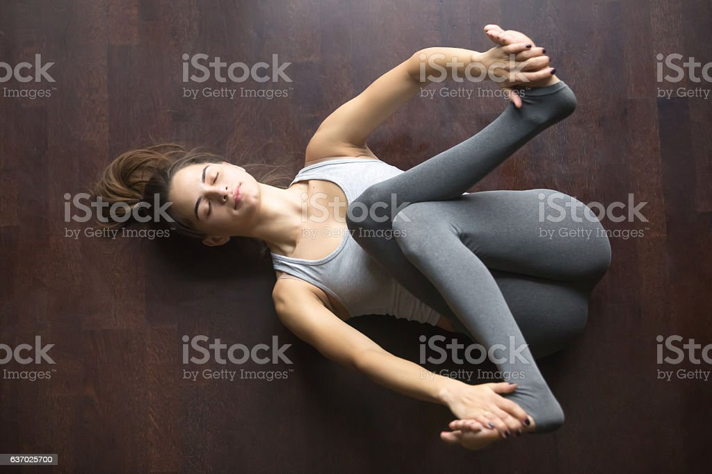 Top view of Supta Gomukhasana yoga pose stock photo