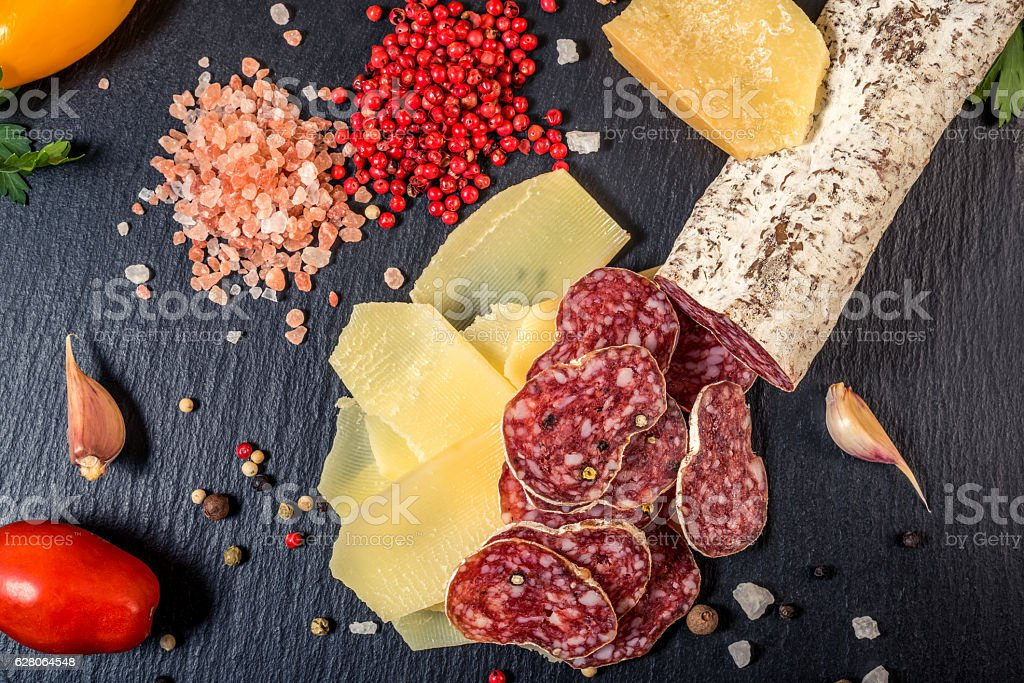 top view of tasty fresh yellow thin slice parm cheese, stock photo