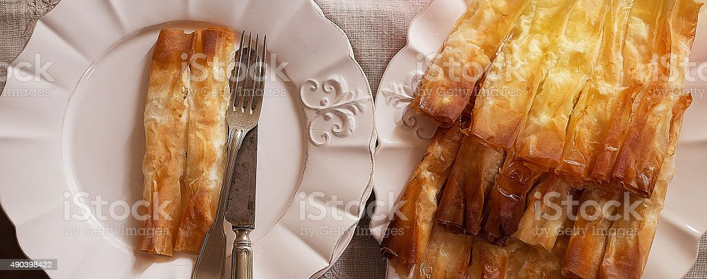 Top view of tasty pastry in porcelain plates stock photo