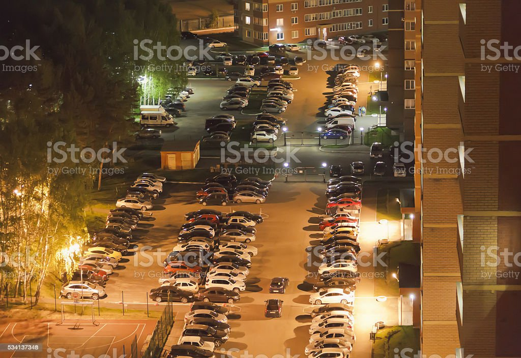 Top view of the Parking of cars near high-rise buildings. stock photo