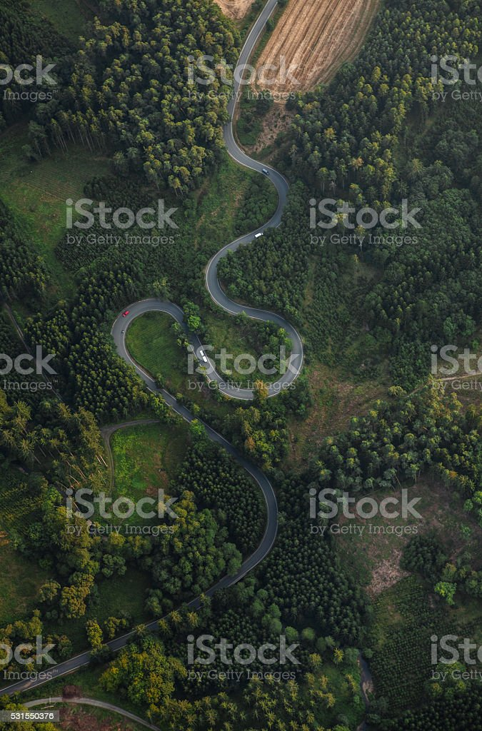 Top view of the path through the trees. View from balloon stock photo