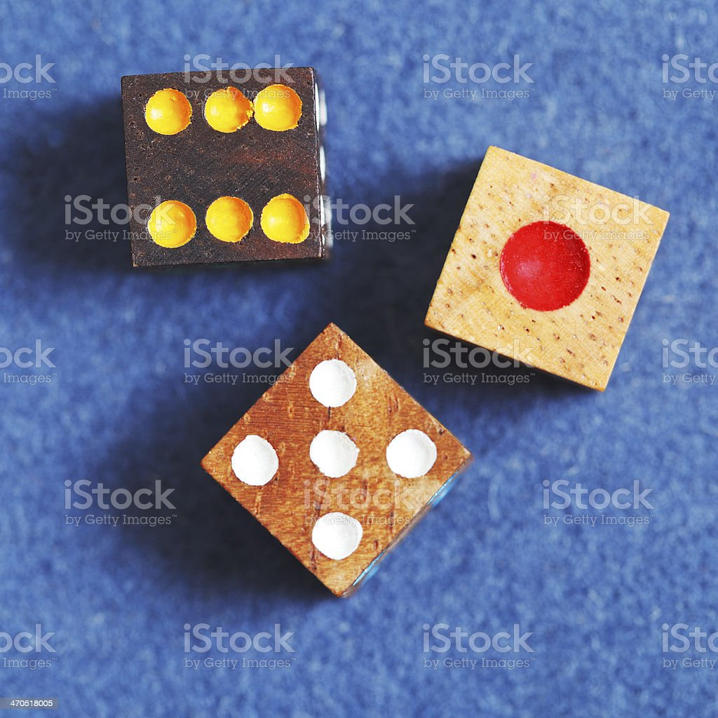 top view of three wooden gambling dices stock photo