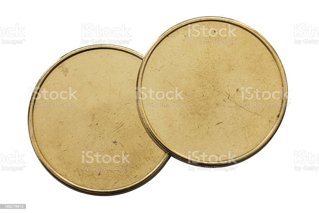 Top view of Two generic used blank coins on white royalty-free stock photo