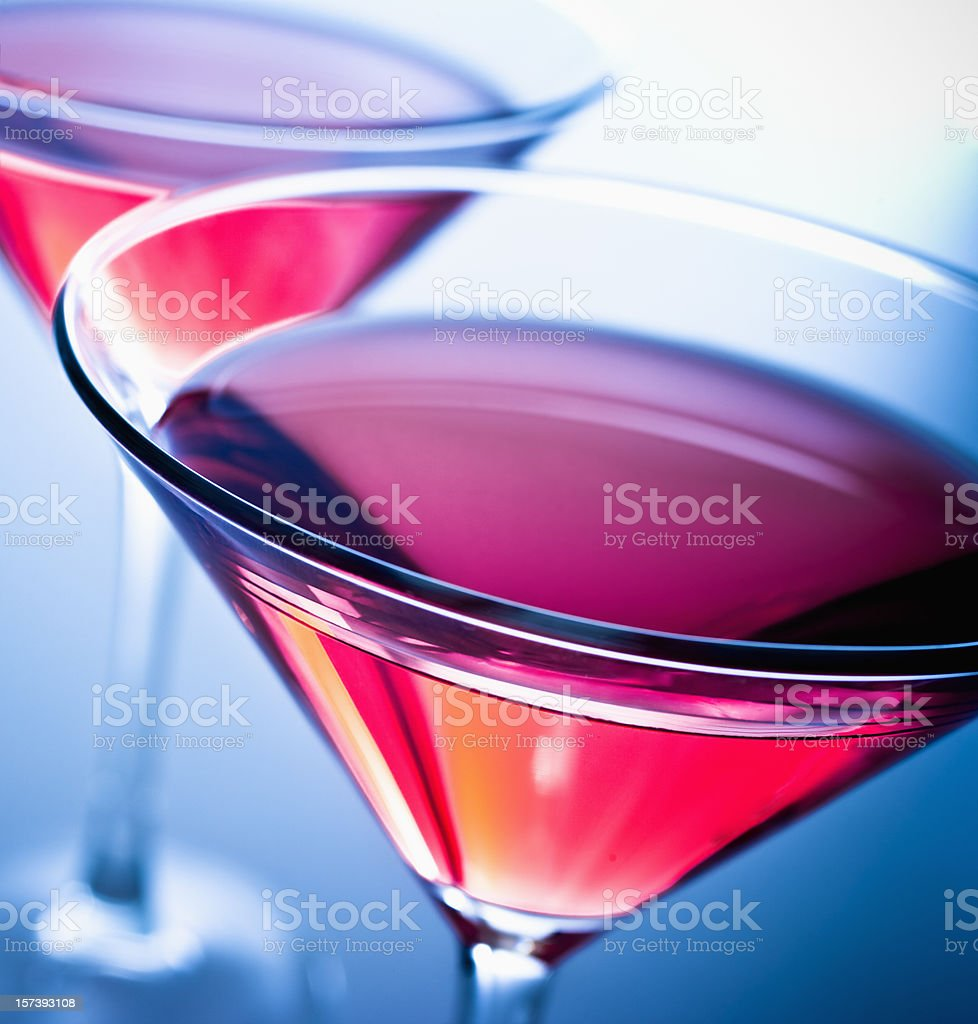 Top view of two pink cosmopolitan drinks on blue background stock photo