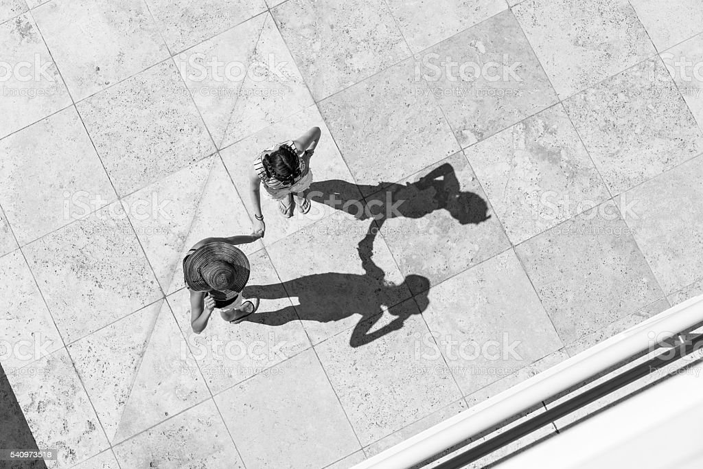 Top view of two teenager girls talking on the sun stock photo