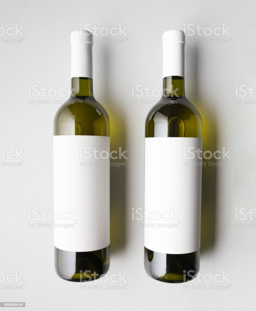 Top view of two wine bottles stock photo