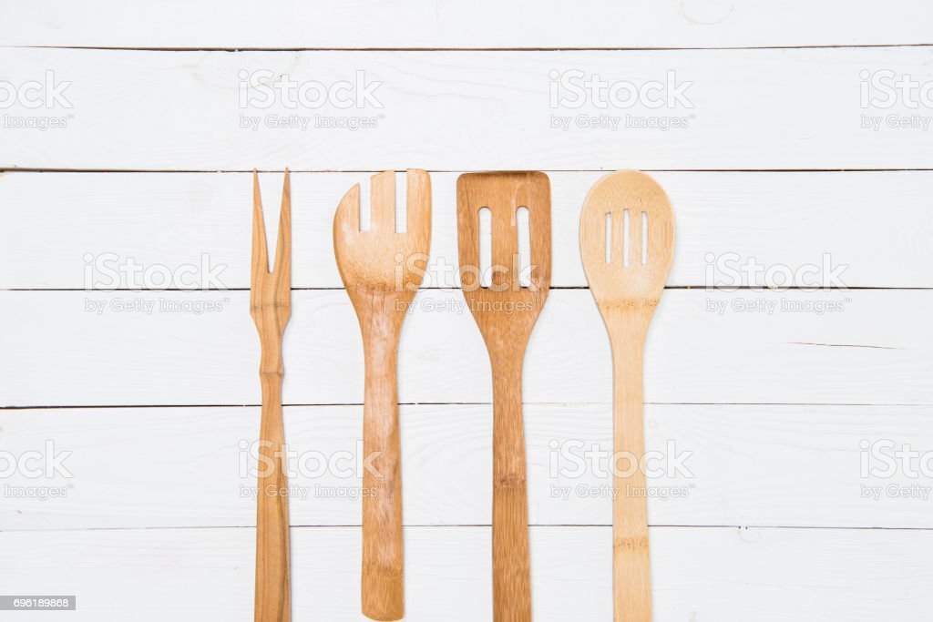 top view of various wooden spatulas on white tabletop stock photo