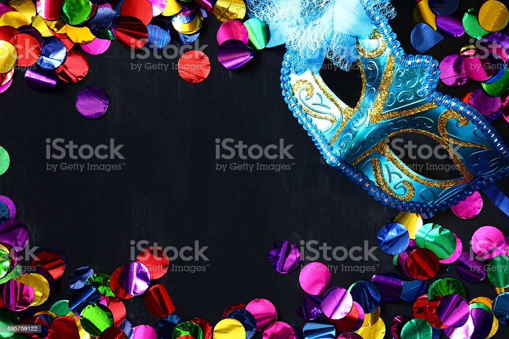 Top view of venetian masquerade mask and colorfull confetti. stock photo