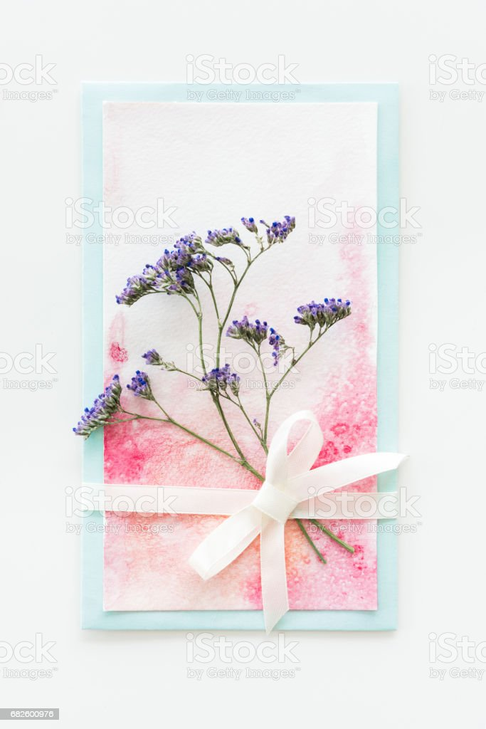 top view of watercolor invitation with flower and ribbon isolated on white, wedding invitation floral concept stock photo
