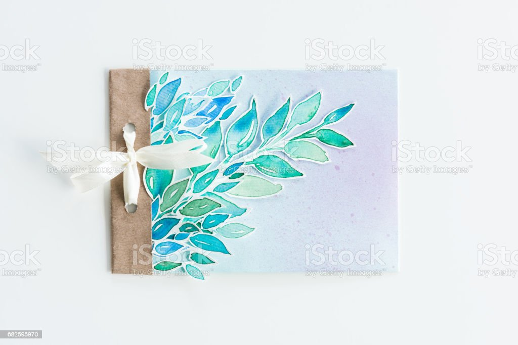 top view of watercolor invitation with leaves and ribbon isolated on white, wedding invitation floral concept stock photo