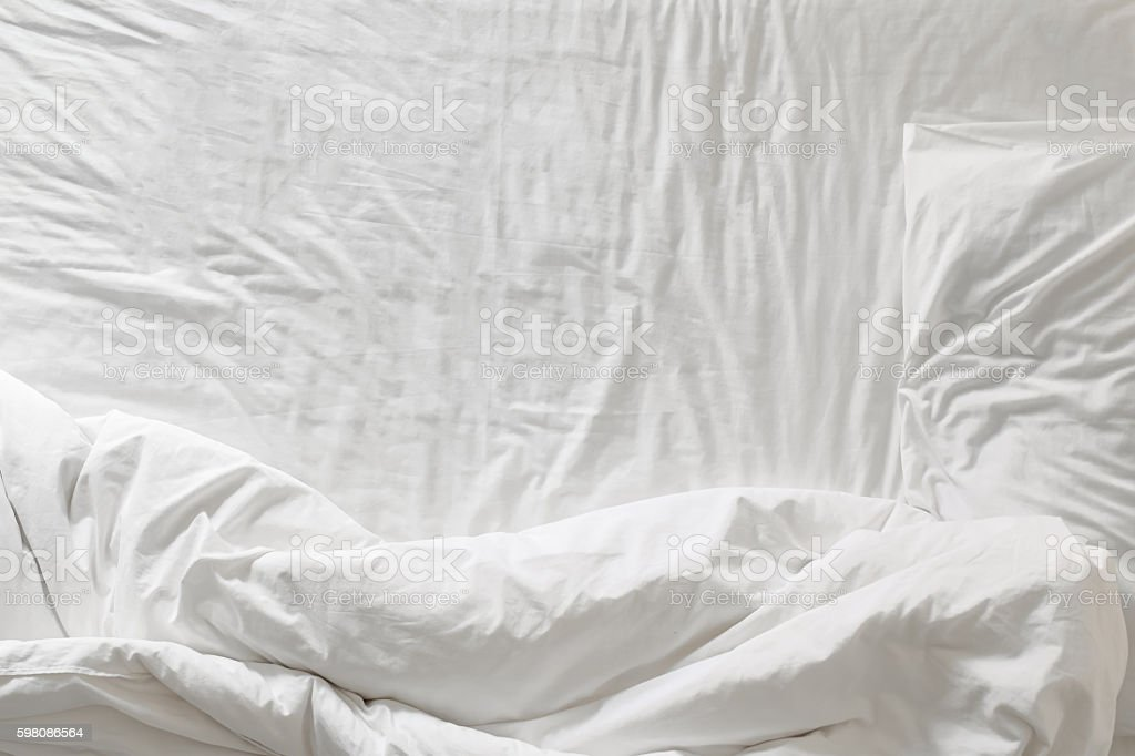 Top view of white bedding and pillow at morning time stock photo