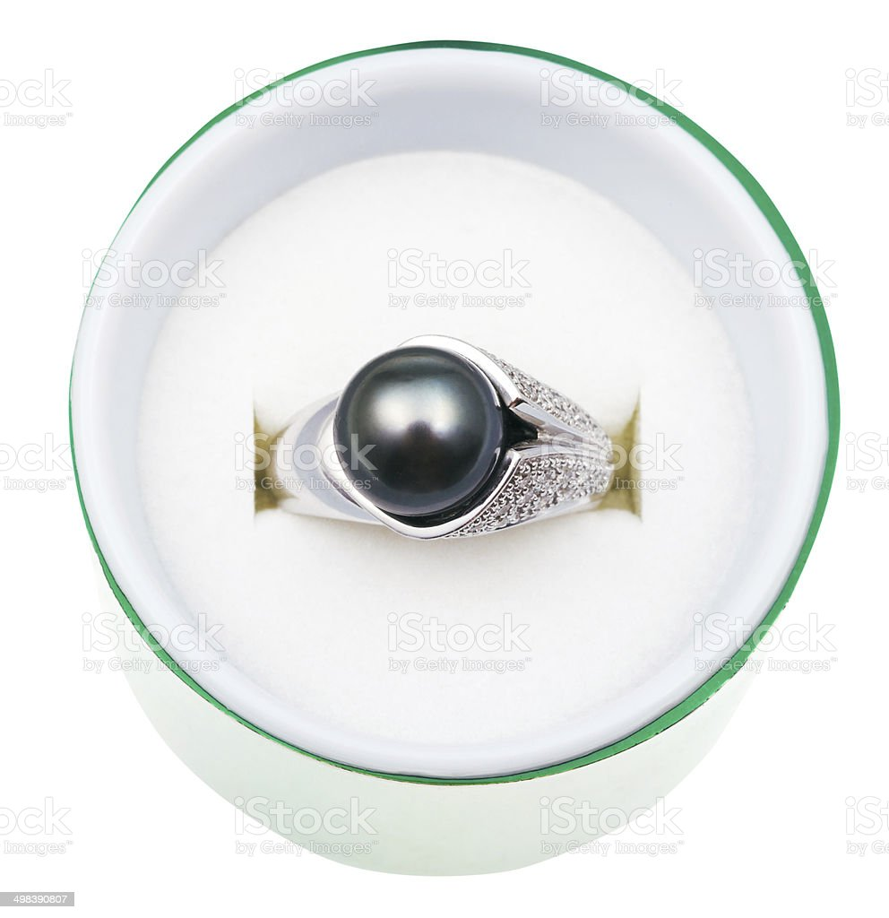 top view of white ring with black pearl in box stock photo