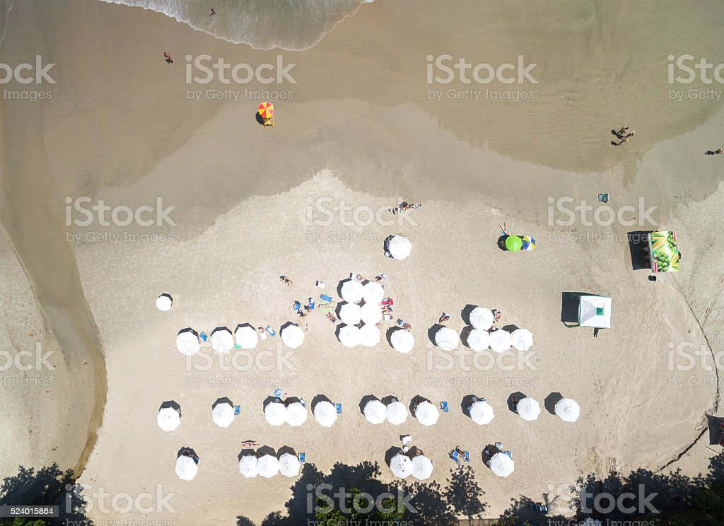 Top View of White Umbrellas in a Beach stock photo