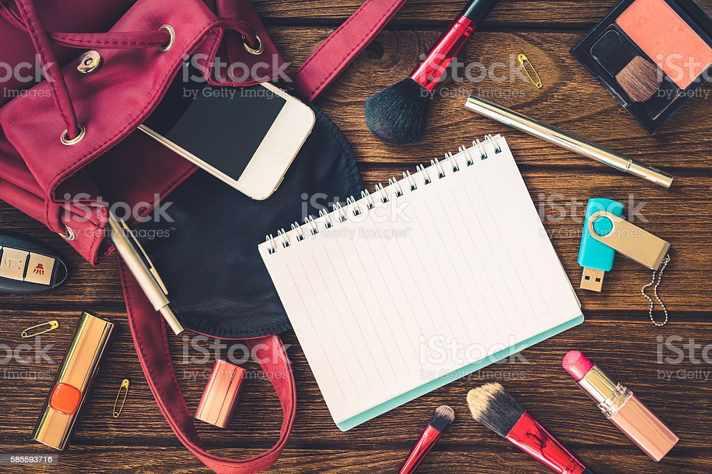 Top view of women bag stuff female accessories stock photo