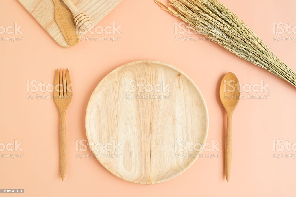 Top view of wooden plate fork spoon stock photo