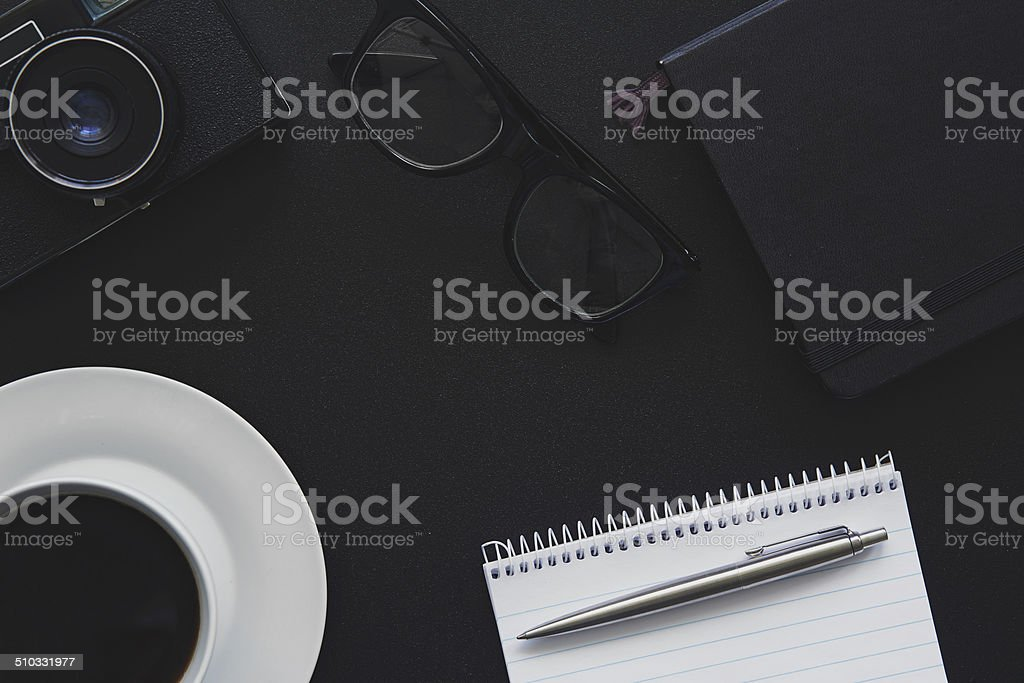 Top view of workplace Photographer. Toned stock photo