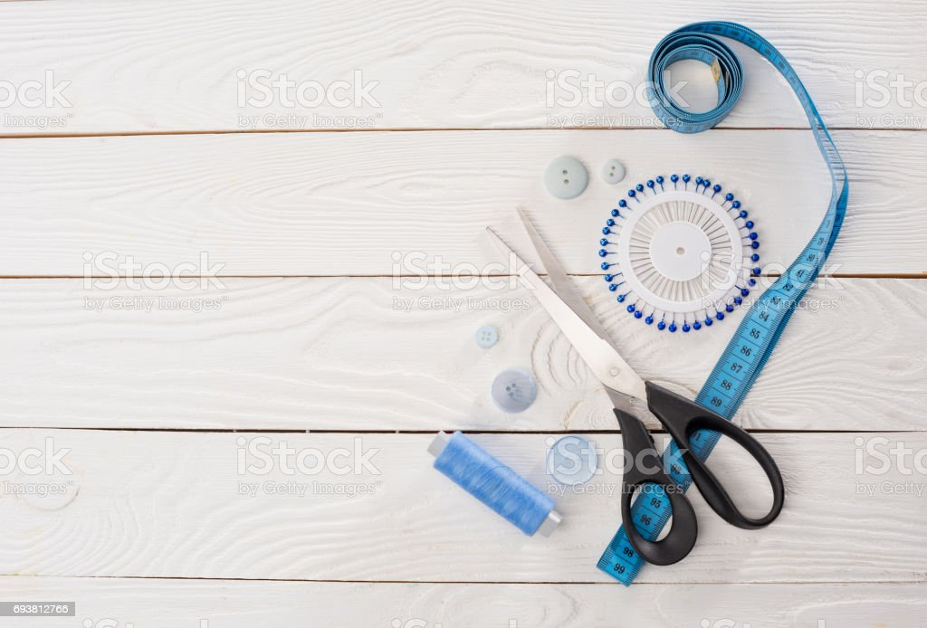 top view of workshop with needlework details and tools mock-up stock photo