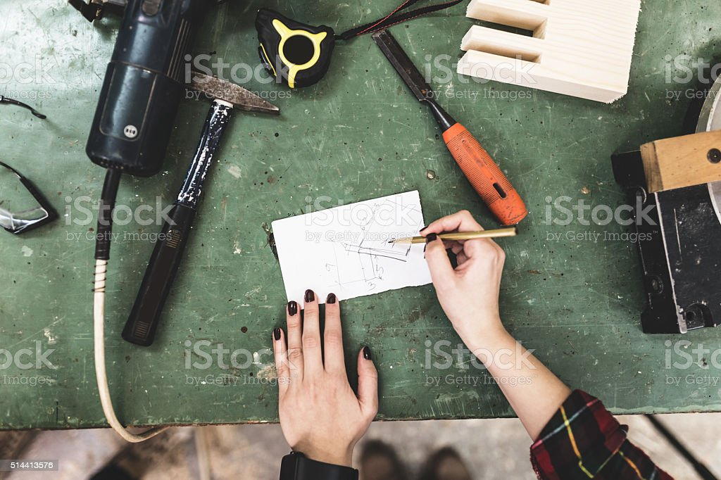 Top view of worshop table with woman hands, flat lay stock photo