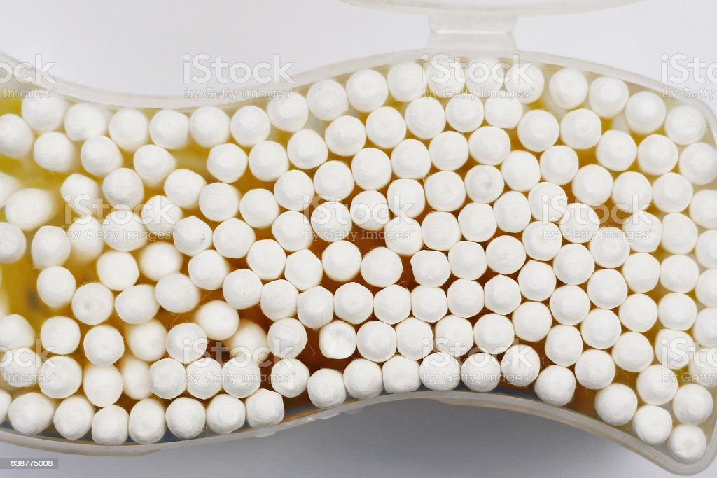 Top view of yellow cotton buds isolated on white stock photo