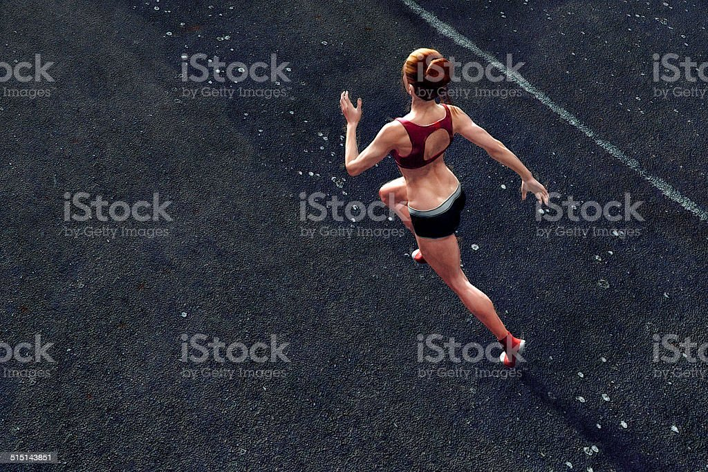 Top view of young woman jogging stock photo