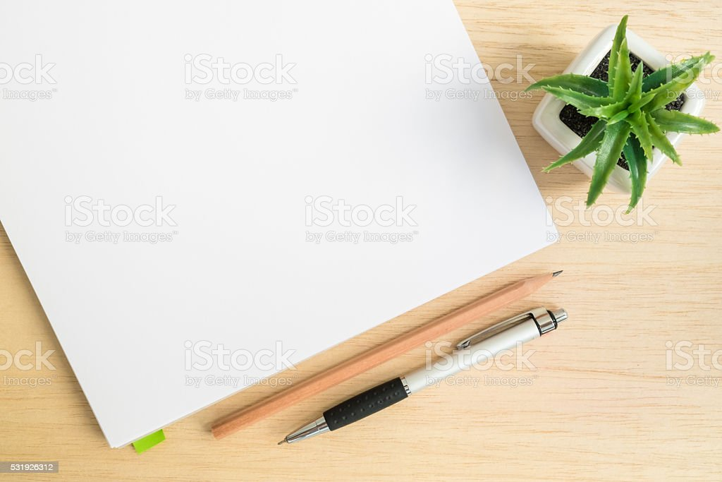 Top view office desk with open notebook on table stock photo