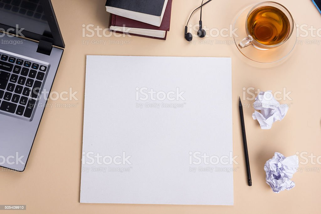 Top view office table with notepad, computer and coffee cup stock photo