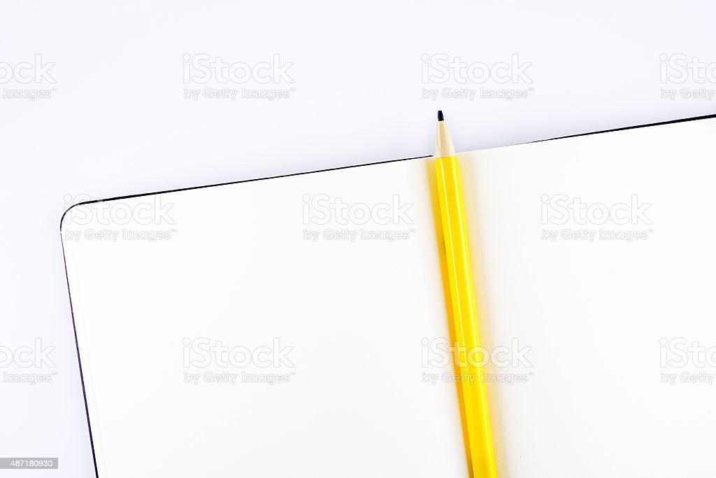 top view ofOpen notebook and yellow pencil stock photo
